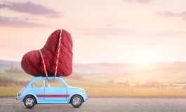 Retro toy car with Valentine heart Stock Photography