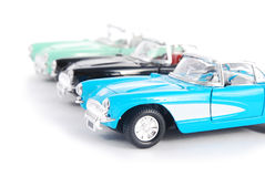 Retro toy cars. Three retro toy cars isolated on white background Stock Photo