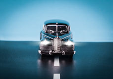 Retro toy cars on the road Royalty Free Stock Photo