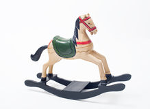 Retro toy horse. On a white background royalty free stock image