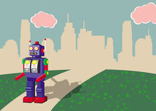 Retro toy robot walking in a retro landscape. This image represents a retro toy robot walking away from a town in a retro landscape Stock Images