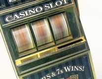 Retro toy slot machine spinning. To win stock photos