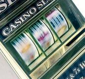 Retro toy slot machine spinning Stock Photo