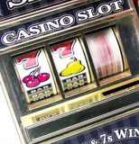 Retro toy slot machine spinning. To win royalty free stock photography