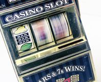 Retro toy slot machine spinning. To win stock photography