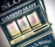 Retro toy slot machine spinning Royalty Free Stock Photography