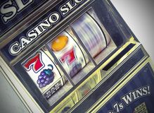 Retro toy slot machine spinning Royalty Free Stock Photo