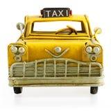 Retro toy taxi. Old retro toy yellow taxi isolated on white background Stock Photo