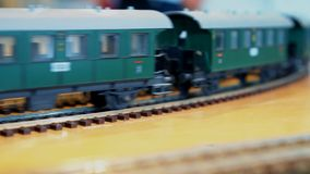 Retro toy train. Retro toy train with wagons moving stock video