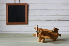 Retro toy on wooden board place Stock Photos