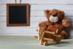 Retro toy on wooden board place text Stock Image