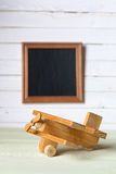 Retro toy on wooden board place text Royalty Free Stock Photography