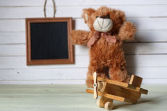 Retro toy on wooden board place text Stock Photography
