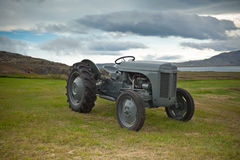 Retro Tractor on the Iceland field Royalty Free Stock Photos