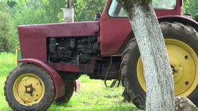 Retro tractor in spring farm garden and beehive stock video