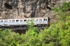 Retro train. Is slowly traveling on cliffs and trees Royalty Free Stock Photography