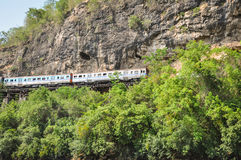 Retro train. Is slowly traveling on cliffs and trees Stock Photography