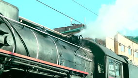 Retro train. The steam from the engine. HD stock footage