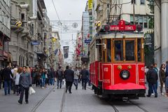 Retro tram on Istiklal street in Istambul. STANBUL, TURKEY - APRIL 25, 2014: Retro tram moves along a busy Istiklal street in Istambul Royalty Free Stock Photos