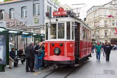 Retro tram on Istiklal street in Istambul. STANBUL, TURKEY - APRIL 25, 2014: Retro tram moves along a busy Istiklal street in Istambul Stock Photo