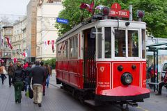 Retro tram on Istiklal street in Istambul. STANBUL, TURKEY - APRIL 25, 2014: Retro tram moves along a busy Istiklal street in Istambul Stock Photography