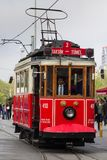 Retro tram on Istiklal street in Istambul. STANBUL, TURKEY - APRIL 25, 2014: Retro tram moves along a busy Istiklal street in Istambul Royalty Free Stock Photo