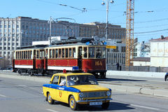 Retro Tram in Moscow. Retro Tram and retro the police car passing on the Big Ustinsky bridge in Moscow Stock Images