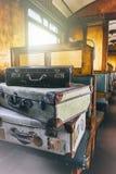 Retro travel cases in last century train coach Stock Photos