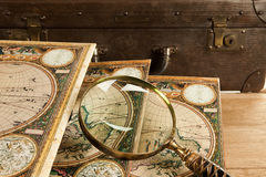 Retro travelling set. Travelling set - Retro suitcase, magnifier and world map Stock Image