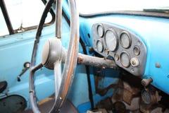 Retro truck dashboard and steering wheel Stock Photos
