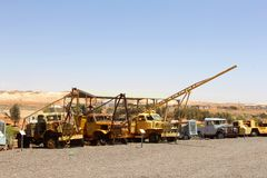 Row of retro trucks and equipment for opal mining, Andamooka, Australia Royalty Free Stock Photos