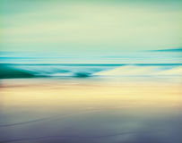Retro Tube Wave. An abstract seascape made with a long exposure. Image displays a retro, vintage look with cross-processed colors stock images