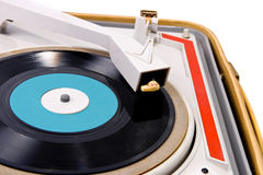 Retro turntable. Retro portable turntable with vinyl record Royalty Free Stock Photography