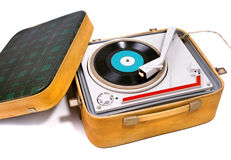 Retro turntable. Retro portable turntable with vinyl record Stock Photo