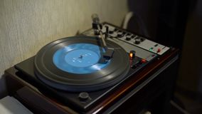 Retro Turntable Playing Blue Vinyl Record. Vintage Turntable Playing Blue Vinyl Record in Retro Style Appartement stock video footage