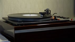 Retro Turntable Playing Vinyl Record. Vintage Turntable Playing Vinyl Record in Retro Style Appartement stock video