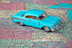 Retro turquoise car on road map Royalty Free Stock Image