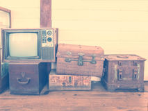 Retro tv and boxes on wooden floor, vintage style Royalty Free Stock Photography