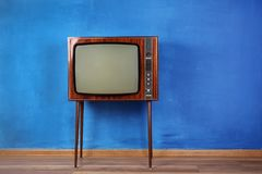 Retro TV on color  background. Retro TV on color wall background Stock Photography