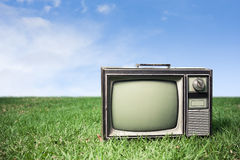 Retro Tv on grass. Photo of retro tv on grass Stock Photos