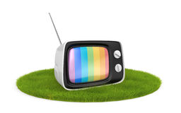 Retro TV on the grass Royalty Free Stock Photo