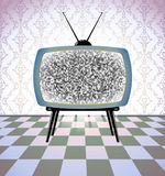 Retro TV in a grey room Stock Images
