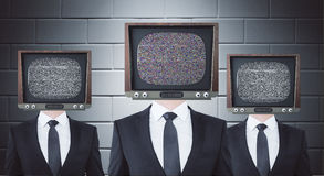 Retro TV headed businessmen stock photography