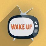 Retro TV och uttrycket 'vaknar upp' på skärmen Arkivbild