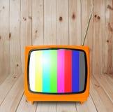 Retro tv. Orange retro tv with wooden case in room Stock Images
