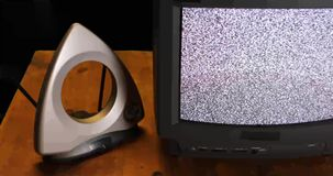 Retro TV and rabbit ears with snow and sound stock video footage