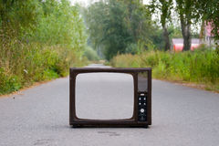 Retro TV on the road Royalty Free Stock Image