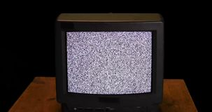 Retro TV screen with snow noise and sound stock video