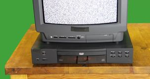 Vintage TV and DVD player on green screen with sound stock video