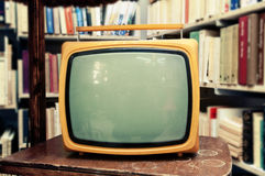 Retro TV set in vintage setting - old living room Royalty Free Stock Photos